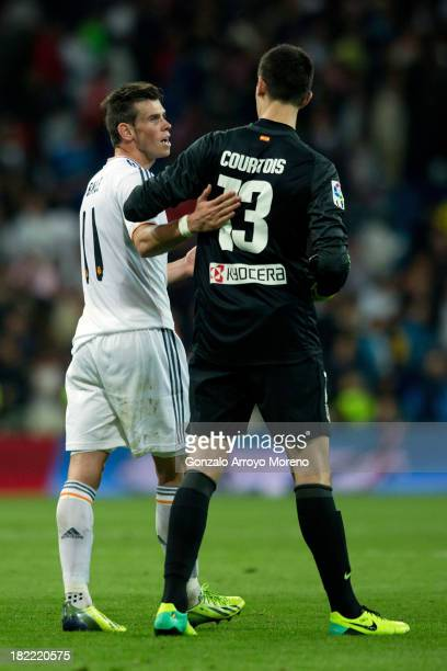 Gareth Bale of Real Madrid CF apologizes to goalkeeper Thibaut Courtois of Atletico de Madrid for his tackle during the La Liga match between Real...