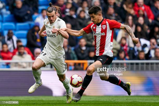 Gareth Bale of Real Madrid CF battle for the ball with Yuri Berchiche of Athletic Club during the La Liga match between Real Madrid CF and Athletic...