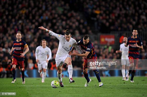 Gareth Bale of Real Madrid CF battles for the ball with Jordi Alba of FC Barcelona during the La Liga match between FC Barcelona and Real Madrid CF...