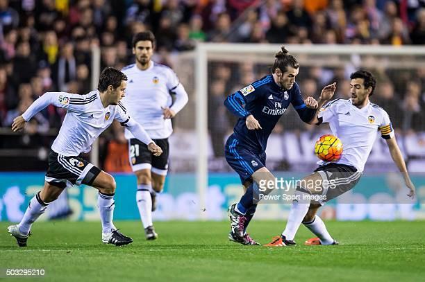 Gareth Bale of Real Madrid CF being followed by Lucas Orban of Valencia CF and Daniel Parejo of Valencia CF during the Valencia CF vs Real Madrid CF...