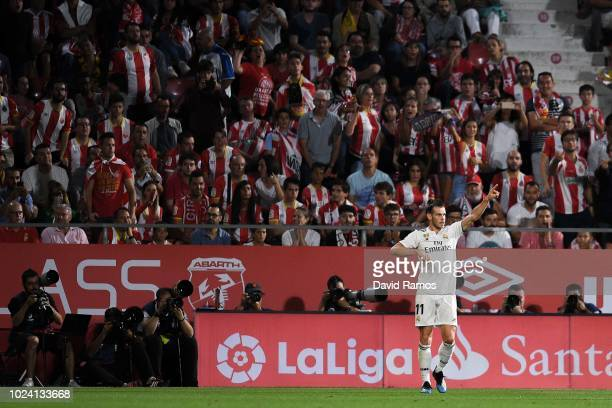 Gareth Bale of Real Madrid CF celebrates after scoring his team's third goal during the La Liga match between Girona FC and Real Madrid CF at...