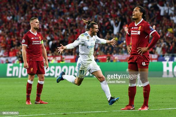 Gareth Bale of Real Madrid CF celebrates after scoring his team's third goal during the UEFA Champions League final between Real Madrid and Liverpool...