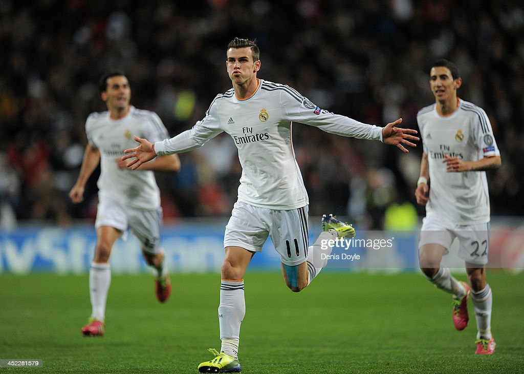 Gareth Bale (C) of Real Madrid CF celebrates after scoring Real's opening goal during the UEFA Champions League group B match between Real Madrid CF v Galatasaray AS at Estadio Santiago Bernabeu on November 27, 2013 in Madrid, Spain.