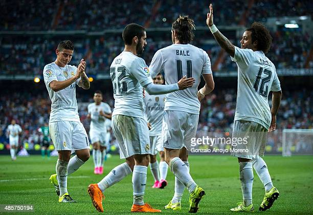 Gareth Bale of Real Madrid CF celebrates scoring their fifth goal with teammates James Rodriguez , Francisco Roman Alarcon alias Isco and Marcelo...