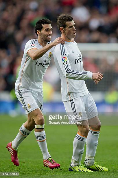 Gareth Bale of Real Madrid CF celebrates scoring their second goal with teammate Alvaro Arbeloa during the La Liga match between Real Madrid CF and...