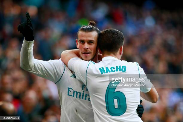 Gareth Bale of Real Madrid CF celebrates scoring their second goal with teammate Nacho Fernandez during the La Liga match between Real Madrid CF and...