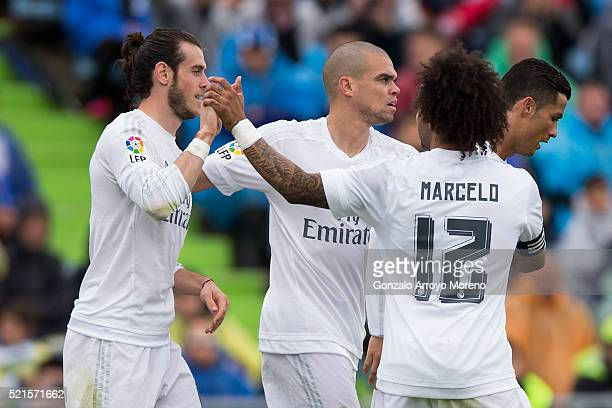 Gareth Bale of Real Madrid CF celebrates scoring their third goal with teammates Pepe Marcelo and Cristiano Ronaldo during the La Liga match between...
