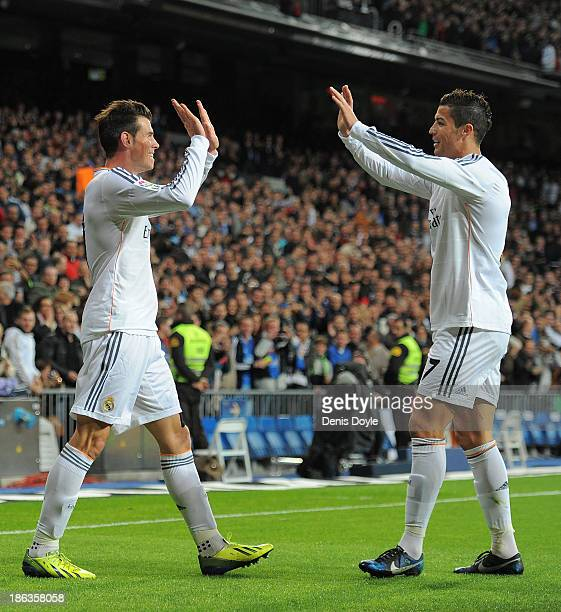 Gareth Bale of Real Madrid CF celebrates with Cristiano Ronaldo after scoring Real's opening goal during the La Liga match between Real Madrid CF and...