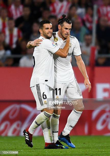 Gareth Bale of Real Madrid CF celebrates with his team mate Nacho Fernandez after scoring his team's third goal during the La Liga match between...