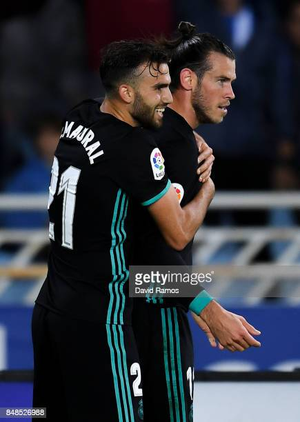 Gareth Bale of Real Madrid CF celebrates with his team mates Borja Mayoral after scoring his team's third goal during the La Liga match between Real...