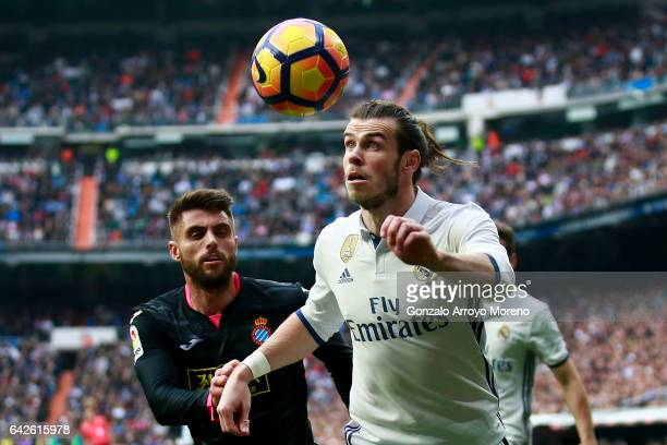 Gareth Bale of Real Madrid CF competes for the ball with David Lopez of RCD Espanyol during the La Liga match between Real Madrid CF and RCD Espanyol...