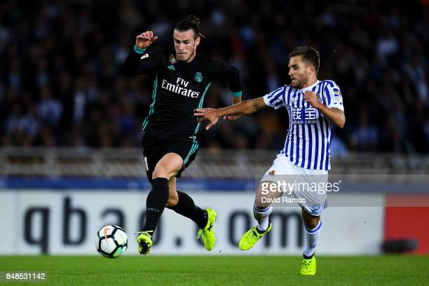 Gareth Bale of Real Madrid CF competes for the ball with Kevin Rodrigues of Real Sociedad de Futbol to score his team's third goal during the La Liga...