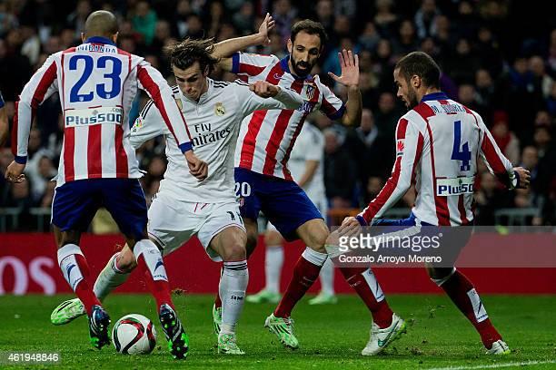 Gareth Bale of Real Madrid CF competes for the ball with Mario Suarez and his teammates Joao Miranda and Juan Francisco Torres alias Juanfran during...