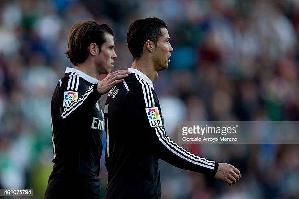 Gareth Bale of Real Madrid CF consoles his teammate Cristiano Ronaldo as he leaves the pitch after being reprimanded with a red card during the La...