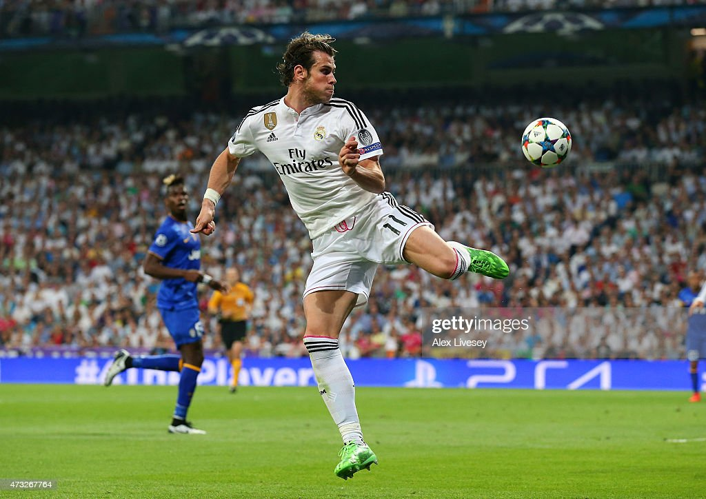 Gareth Bale of Real Madrid CF controls the ball during the UEFA Champions League Semi Final second leg match between Real Madrid CF and Juventus at Estadio Santiago Bernabeu on May 13, 2015 in Madrid, Spain.
