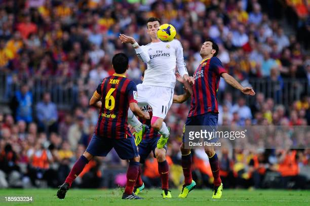 Gareth Bale of Real Madrid CF duels for the ball with Sergio Busquets of FC Barcelona during the La Liga match between FC Barcelona and Real Madrid...