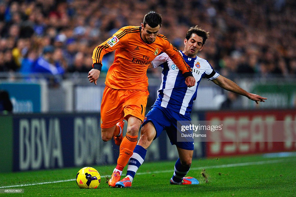 Gareth Bale of Real Madrid CF duels for the ball with Victor Sanchez of RCD Espanyol during the La Liga match between RCD Espanyol and Real Madrid CF at Cornella-El Prat Stadium on January 12, 2014 in Barcelona, Spain.
