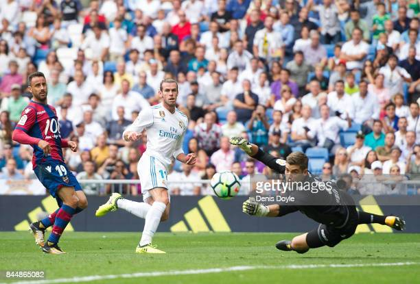 Gareth Bale of Real Madrid CF has his shot saved by Raul Fernandez of Levante UD during the La Liga match between Real Madrid and Levante at Estadio...