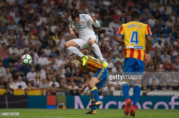 Gareth Bale of Real Madrid CF heads the ball during the La Liga match between Real Madrid CF and Valencia CF at Estadio Santiago Bernabeu on August...