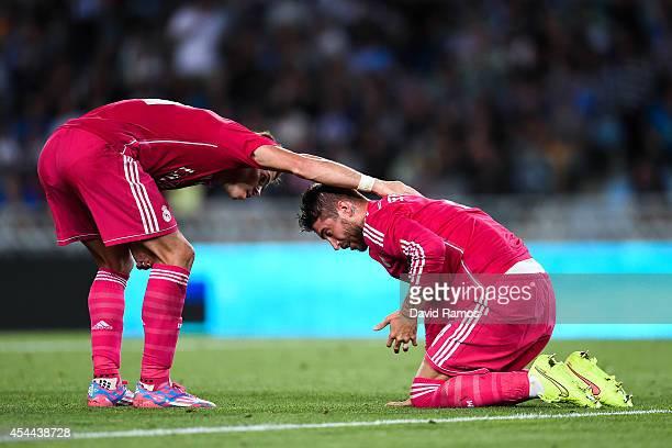Gareth Bale of Real Madrid CF helps to his teammate Sergio Ramos of Real Madrid CF during the La Liga match between Real Sociedad de Futbol and Real...