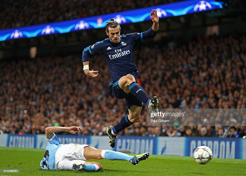 Gareth Bale of Real Madrid CF hurdles the challenge from Jesus Navas of Manchester City during the UEFA Champions League Semi Final first leg match between Manchester City FC and Real Madrid at the Etihad Stadium on April 26, 2016 in Manchester, United Kingdom.