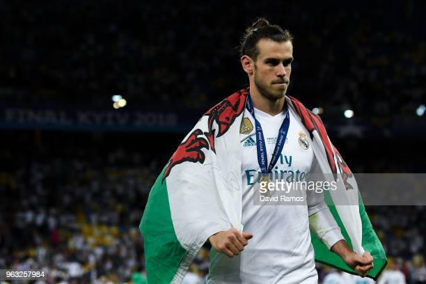 Gareth Bale of Real Madrid CF leaves the pitch following his side victory in the UEFA Champions League final between Real Madrid and Liverpool on May...