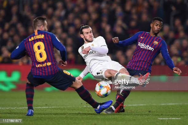 Gareth Bale of Real Madrid CF misses a chance to score under a challenge by Arthur Melo and Nelso Semedo of FC Barcelona during the Copa del Semi...