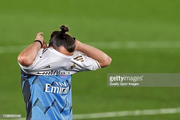 Gareth Bale of Real Madrid CF putting a jersey of winners during the La Liga match between Real Madrid CF and Villarreal CF at Estadio Alfredo Di...