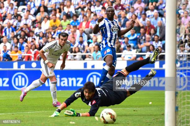 Gareth Bale of Real Madrid CF scores his team's fourth goal during the La Liga match between RC Deportivo La Coruna and Real Madrid CF at Riazor...