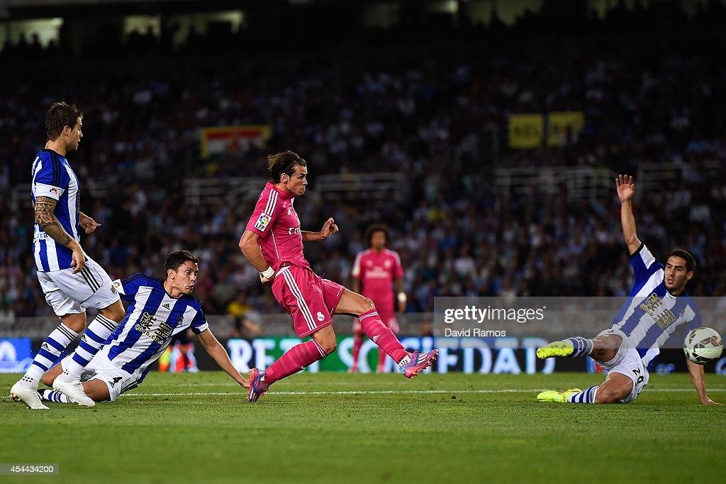 Gareth Bale of Real Madrid CF scores his team's second goal during the La Liga match between Real Sociedad de Futbol and Real Madrid CF at Estadio Anoeta on August 31, 2014 in San Sebastian, Spain.