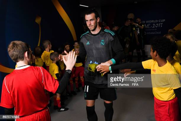 Gareth Bale of Real Madrid CF shakes hands with FIFA boys as he walks out the tunnel area priot to the FIFA Club World Cup semi-final match between...
