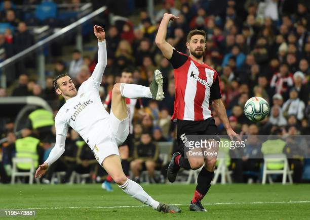 Gareth Bale of Real Madrid CF tries to connect to a pass beside Yeray Alvarez of Athletic Club during the Liga match between Real Madrid CF and...