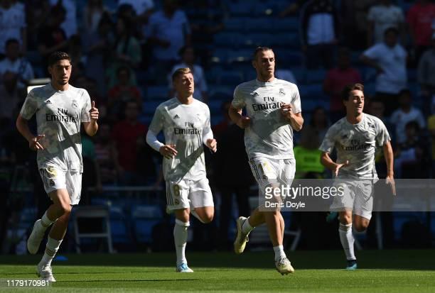 Gareth Bale of Real Madrid CF warms up with teammates ahead of the Liga match between Real Madrid CF and Granada CF at Estadio Santiago Bernabeu on...