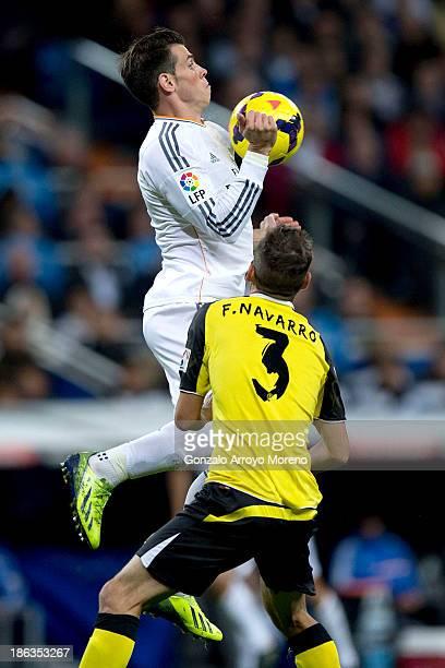 Gareth Bale of Real Madrid CF wins the chest before Fernando Navarro of Sevilla FC during the La Liga match between Real Madrid CF and Sevilla FC at...