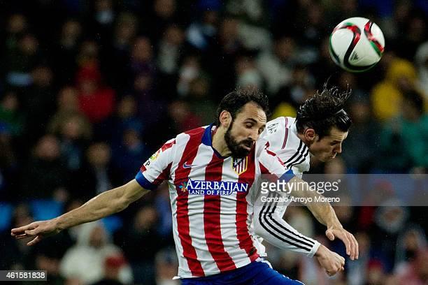 Gareth Bale of Real Madrid CF wins the header before Juan Francisco Torres alias Juanfran of Atletico de Madrid during the Copa del Rey Round of 16...