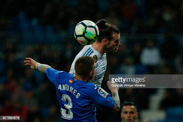 Gareth Bale of Real Madrid CF wins the header before Vitorino Antunes of Getafe CF during the La Liga match between Real Madrid CF and Getafe CF at...