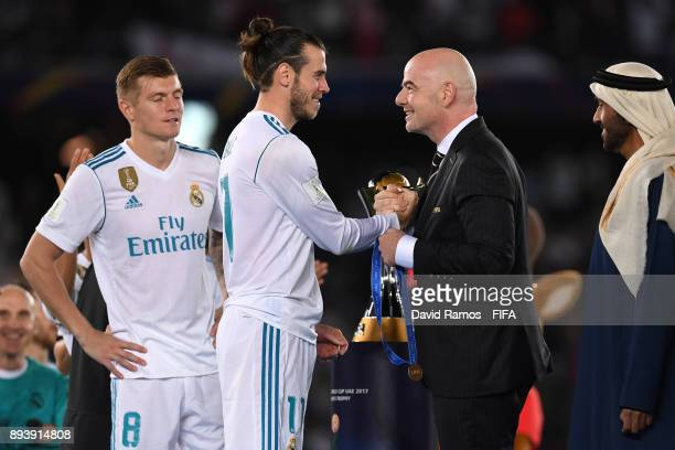 Gareth Bale of Real Madrid collects his winners medal from Gianni Infantino during the FIFA Club World Cup UAE 2017 Final between Gremio and Real...