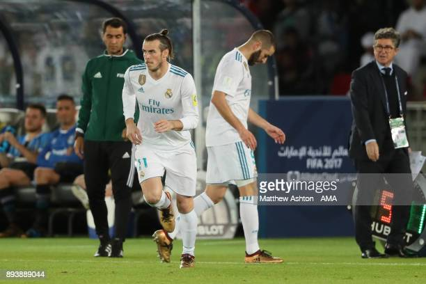 Gareth Bale of Real Madrid comes on as a substitute for Karim Benzema during the FIFA Club World Cup UAE 2017 final match between Gremio and Real...