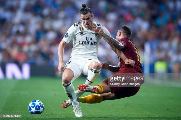 Gareth Bale of Real Madrid competes for the ball with Aleksandar Kolarov of AS Roma during the Group G match of the UEFA Champions League between...