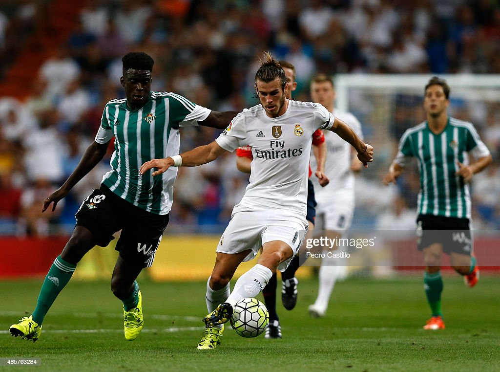 Gareth Bale of Real Madrid competes for the ball with Alfred N'Diaye of Real Betis during the La Liga match between Real Madrid CF and Real Betis Balompie at Estadio Santiago Bernabeu on August 29, 2015 in Madrid, Spain.