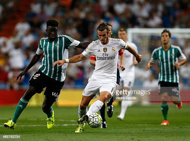 Gareth Bale of Real Madrid competes for the ball with Alfred N'Diaye of Real Betis during the La Liga match between Real Madrid CF and Real Betis...
