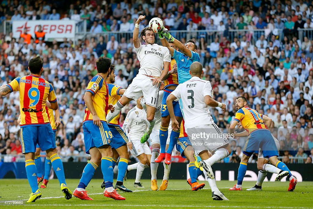 Gareth Bale of Real Madrid competes for the ball with Diego Alves of Valencia during the La Liga match between Real Madrid CF and Valencia CF at Estadio Santiago Bernabeu on May 9, 2015 in Madrid, Spain.