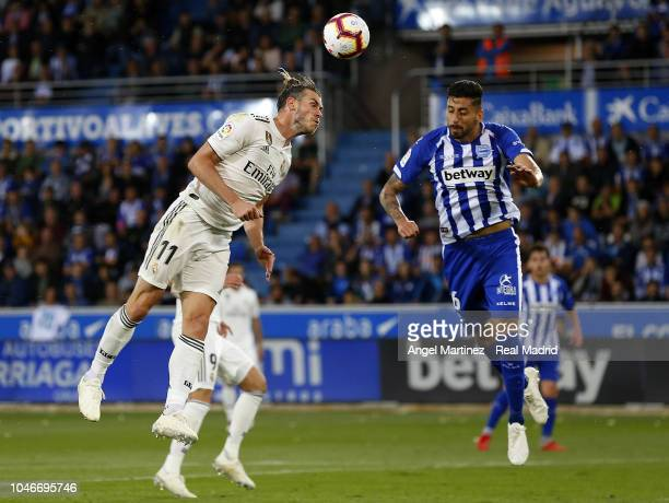 Gareth Bale of Real Madrid competes for the ball with Guillermo Maripan of Deportivo Alaves during the La Liga match between Deportivo Alaves and...