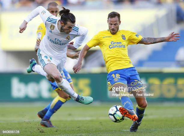 Gareth Bale of Real Madrid competes for the ball with Javi Castellano of UD Las Palmas during the La Liga match between UD Las Palmas and Real Madrid...