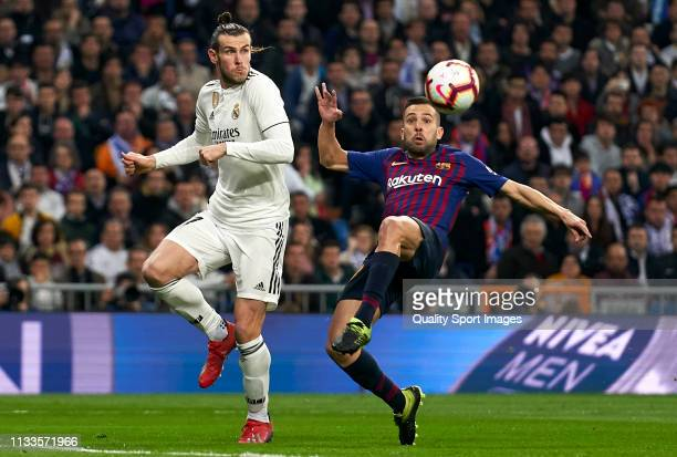 Gareth Bale of Real Madrid competes for the ball with Jordi Alba of Barcelona during the La Liga match between Real Madrid CF and FC Barcelona at...