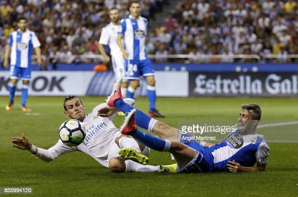 Gareth Bale of Real Madrid competes for the ball with Luisinho of Deportivo La Coruna during the La Liga match between Deportivo La Coruna and Real...