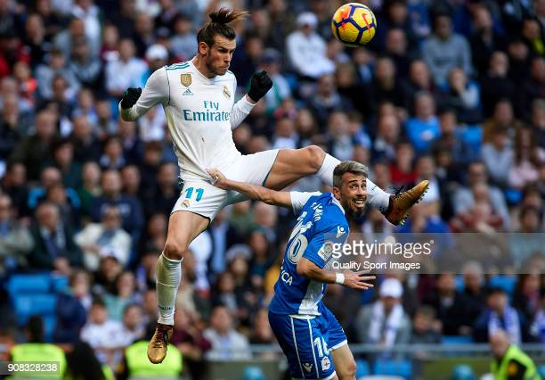 Gareth Bale of Real Madrid competes for the ball with Luisinho Correia of Deportivo de La Coruna during the La Liga match between Real Madrid and...