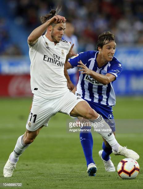 Gareth Bale of Real Madrid competes for the ball with Tomas Pina of Deportivo Alaves during the La Liga match between Deportivo Alaves and Real...