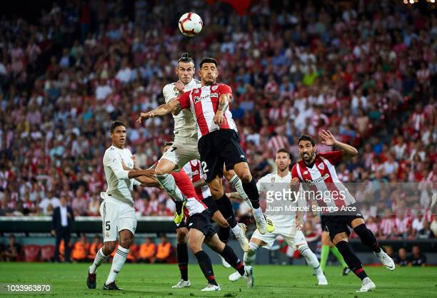 Gareth Bale of Real Madrid competes for the ball with Yuri Berchiche of Athletic Club during the La Liga match between Athletic Club Bilbao and Real...