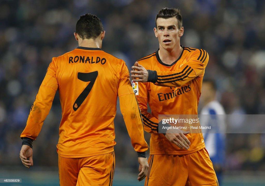Gareth Bale (R) of Real Madrid consoles Cristiano Ronaldo during the La Liga match between RCD Espanyol and Real Madrid at Cornella-El Prat Stadium on January 12, 2014 in Barcelona, Spain.